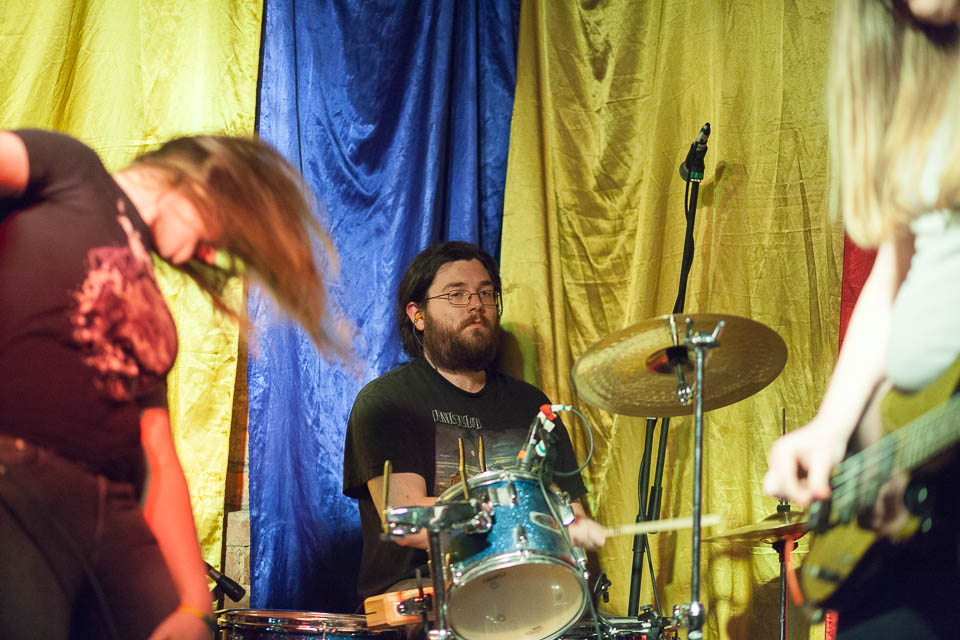 Drummer providing a forceful backing to the bass fuzz and vox.